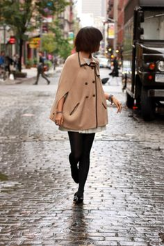 Another camel cape with great black piping. Also from tumblr.