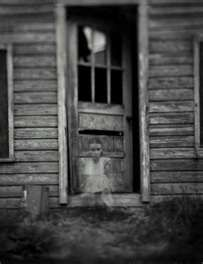 The ghost of the teenage girl waits to go back inside. All she can think about is unfinished business.