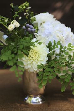 Natural floral arrangement - white flowers, berries, and clover