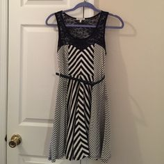 Striped black and white dress Skater dress lace top of the dress in good condition. About 32 inches long from shoulders to hem. Just ginger Dresses