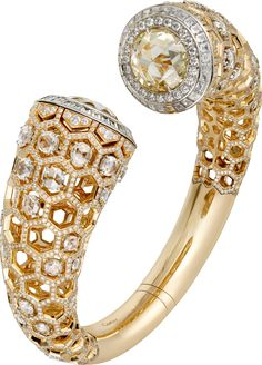 "CARTIER. High Jewellery ""Honeycomb"" visible hour watch, mechanical movement with manual winding, calibre Cartier 8971 MC. Yellow gold and platinum case, one round-shaped rose-cut diamond of 7.31cts, 1,721 brilliant-cut diamonds totaling 6.42cts, 60 rose-cut diamonds totaling 6.61cts, 60 princess-cut diamonds totaling 3.62cts, translucent lacquered golden sunray effect dial, rhodium-finish white gold sword-shaped hands. Water-resistant to 3 bar (approx. 30 meters). Unique piece. #2016"