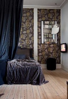 Bedroom in dark colours creates a cool, calm and cozy atmosphere.
