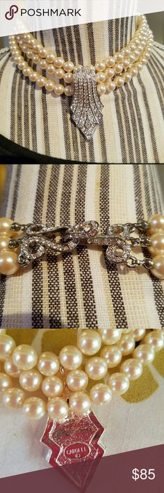 Stunning Vintage Carolee Faux Pearl Necklace This 3 strand faux pearl choker necklace is in excellent condition and all rhinestones on decorative pendant are in tact. The back clasp is gorgeous and all stones are in tact as well. The matching earrings have a tiny stone missing (see pic 4), so this price is for necklace only. I will include earrings if you want to have them fixed. This is an elegant necklace for fancy events; especially if you have shorter hair and can show off the back…