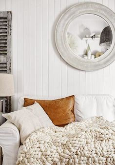 Perfect Leather Pillow, Knarled Throw, Perfect Mirror.  This is the way to do neutrals!