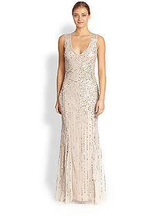 Aidan Mattox Sequin Tulle Sleeveless Gown in Blush $450 -   A pale, airy tulle gown is traced with strands of delicate, silvery sequins, in a design that alludes subtly to Art Deco glamour.  V-neck Sleeveless Side zip closure Skirt godets Semi-sheer back Lined