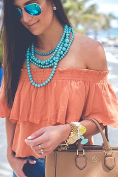 off the shoulder top, turquoise statement necklace, vacation outfit, summer fashion, tassel bracelets, distressed skinny jeans, casual fashion // grace wainwright from @asoutherndrawl