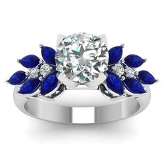 Large Round Cut diamond Side Stone Engagement Rings with Blue Sapphire in 950 Platinum exclusively styled by Fascinating Diamonds