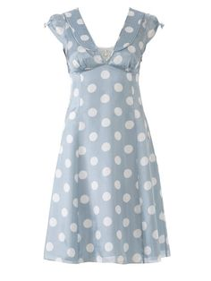 This dress has all your favorite retro elements: decorative buttons, a stylized collar, and a cute fit and flare shape. Make it pop with pol...
