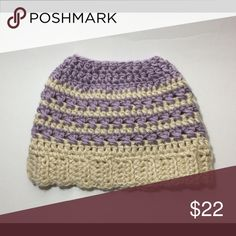 Bun Beanie Messy Bun/Pony tail hat   Colors are customizable  Soft purple, Cream One size fits most.  Made of a thick high quality acrylic  Machine washable Tumble dry   **Please remember that these are handmade. Therefore, each piece will be unique*** Accessories Hats