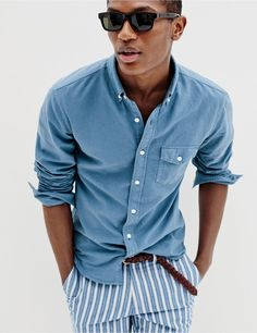 J.Crew men's slim lightweight garment-dyed oxford shirt, Bowery slim pant in variegated-stripe cotton, Irving sunglasses and braided leather belt.