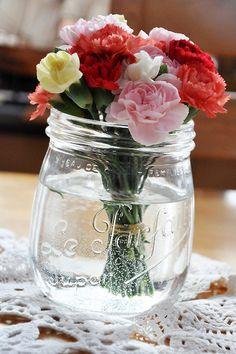 Flowers in glass jar.