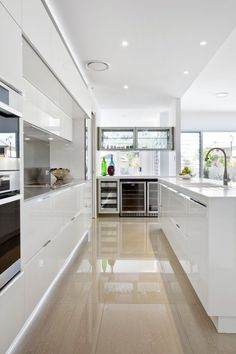 Kitchen - contemporary white kitchen. Very modern, I like the no handles look. Very sleek.