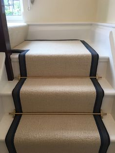 Riviera Henley Chiffon striped cream carpet fitted as stair runner with striped blue taping with Brass stair rods on white painted staircase Striped Carpet Stairs, Striped Carpets, Carpet Staircase, Staircase Runner, White Stairs, Hall Carpet, Stair Runner Rods, Black Painted Stairs, Sisal Stair Runner
