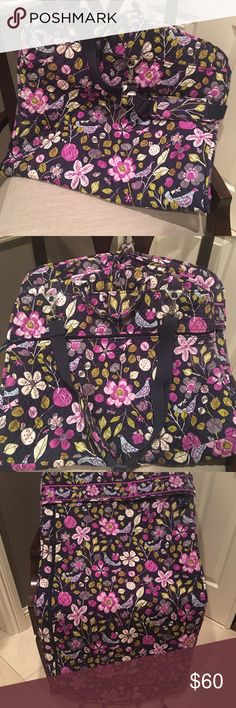 "NWOT! Vera Bradley Garment Bag! Perfect way to travel with wrinkle free hanging clothes! Multiple zip pockets. Detachable hanger hook . 6"" handle drop. Detachable and adjustable shoulder strap.  Beautiful Navy print with purple and grey accents. Tag have been removed but item has never been used! Vera Bradley Accessories"