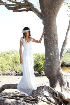 simple beach wedding dress with short sleeves and scooped back