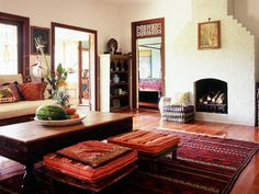 See how a beautiful red rug anchors this Indian-style living room on HGTV.com.