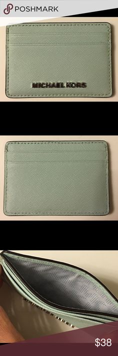 Light blue Michael Kors card case! Barely used! Very nice light sky blue/very light teal Jet Set Michael Kors card case! Saffiano leather. I used this only twice. 100% authentic, purchased from MK boutique! I'm just not enamored with it. But it's a perfect color for someone who likes pastels! I was able to squeeze in about 5 cards, plus there's a slot for bills in between. 🚫No trades, lowballing, PP, Merc, etc., please. Thanks for viewing my closet!😘💗 Michael Kors Bags Wallets