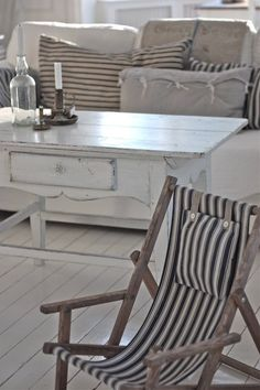 ooh lovely white wooden floor / floorboards, sweet coffee table vintage style and nautical stripe deck chair loving xo