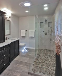 pebble-shower-floor-Bathroom-Transitional-with-bath-storage-black-cherry | Sustainable Living #smallbathroomremodeling