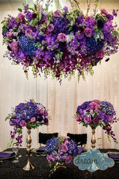 purple hanging floral arrangement sand black sequence