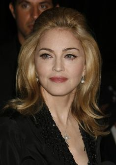 Mother of the Bride or an older bride. Madonna doesn't always sport the most flattering hair for her age, but this softly teased updo is a winner.