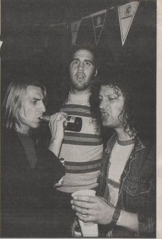 Krist Novoselic with Mark Arm and Matt Lukin from Mudhoney, all in the backstage of Reading Festival, August 1992. Photo by Steve Double for Melody Maker.