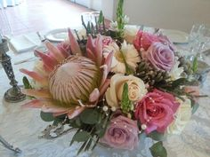 Pink King Protea arrangement with pink, lilac and ivory roses