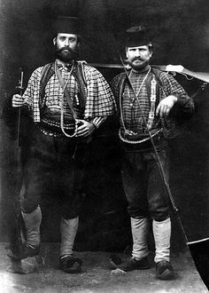 Ottoman Turkish irregulars pose for the camera in this undated photo, most likely from the beginning of the 20th century. Both are carrying the Martini-Henry rifle, a breech-loading single-shot lever-actuated rifle designed by English Henry Peapody and perfected by the Swiss Friedrich von Martini. The H-M rifle was widely available to guerrillas of the time thanks to its adoption by the British Army and the large quantities in which it was produced.