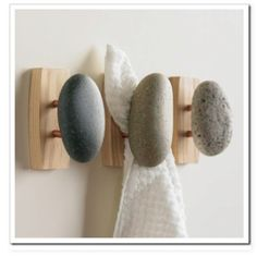 Stone DIY towel hooks for that spa feel via sandandsisal.com I would so have these in my bathroom for regular use! SO pretty!