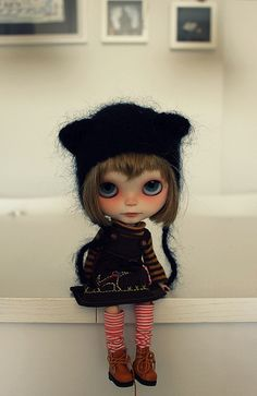 I want this doll, I like how the head is some what out of proportion to the body - making the doll look short and cute!