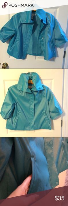 Vintage D & Y lightweight swing jacket. This is a gorgeous statement piece! The only time I've worn it was for a fashion show. It is a rich turquoise with a bit of sheen to it. It has two zippered pockets and zipper and snap closure. The collar has 3 snaps so you can wear it up or down.. The sleeves are 3/4 length with feminine pleats. The only damage is a tiny spot on the inside near the pocket, but is only visible inside the jacket. It's an A-line swing jacket. It's color is so beautiful…