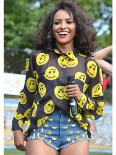 Famous Actress Kat Graham As Bonnie Bennett  From CW Tv Channel Vampire Diaries Tv Show Wearing Her Blue-Denim-Studded Shorts.