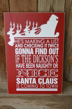 Christmas Santa Claus is coming to town PERSONALIZED sign with vinyl lettering. $18.00, via Etsy.