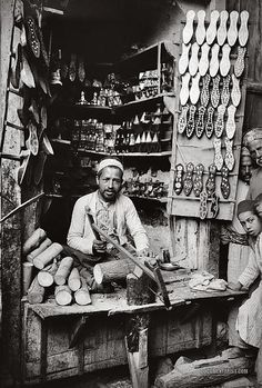 """Damascene inlaid-slipper maker. Damascus, Syria 1900-1920."" Internet description"