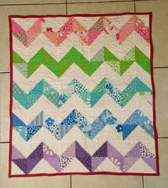 Chevron quilt made with pink, green, aqua, blue, and purple using the charm pack Bandana Charm Pack from Missouri Star Quilt Company.