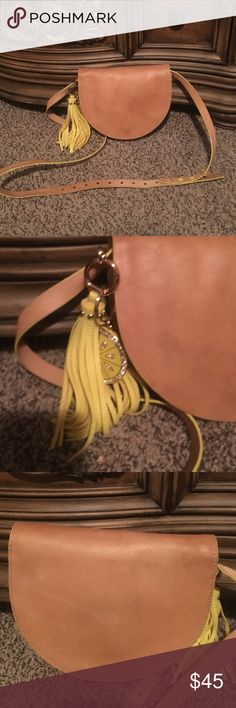 🎉🎉🎉 Authentic Kate Spade Bag Kate spade half moon bag tan color with yellow trimming. The bag does has some water spots on front and back, but the inside is in great condition with the exception of a small blue Mark inside. The tassel & lemon key change was added to bag after I bought it. Plz ask any questions before buying no refunds kate spade Bags Crossbody Bags