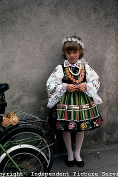 A young polish girl wearing a well-known type of traditional costume from the city of Lowicz, Poland