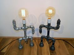 Display a touch of the unique with this Malleable Iron Pipe Robot Lamp from Milton Douglas Lamp Co. This steampunk robot lamp features a single medium base, porcelain socket atop a robot-like body made completely of black malleable iron pipe fittings. The lamp also comes with 8 feet of black, cloth-covered, twisted cord with an in-line switch to complete the retro look.  120 Volts 60 Watts 1 Medium Base (E26) Bulb (Not Included)  Dimensions (Without Bulb) Height 14 Width 8-1/2 Depth 2-1/2