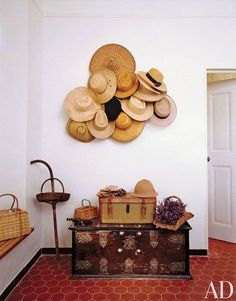 Storage does take up valuable space, so more pinners are having their most beautiful accessories do double-duty as wall decor. In Serena and David Linley's Provence home, the boot room is decorated with an assortment of hats | archdigest.com