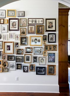 Don't like the amount, nor how tight this many images appears on the wall. I think a few dominant pieces would help.