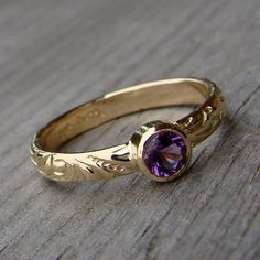 amethyst.. Love the detail on this ring