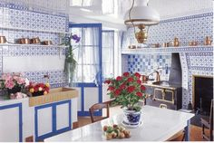 Monet's house is a marvel, particularly the kitchen, a symphony in blue-and-white faïence tile with a pattern that dominates en from floor to ceiling. Tile colors also dictate the scheme of painted cabinets and woodwork.