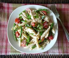 Chicken , Penne Pasta , Asparagus and Grape Tomatoes , with Garlic Primavera Sauce