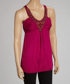 Gleaming beads abound on the front of this contemporary-cool tank. Styled for success on an elegant evening, this top combines eye-catching embellishment with a ruched bodice. Measurements (size S): 29'' long from high point of shoulder to hem95% rayo...