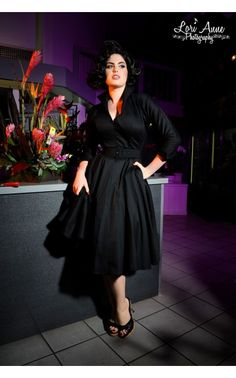 A classic silhouette with a Deadly Dames twist, the Horror Housewife Dress in Black Sateen combines impeccable tailoring and flattering details for a dress that showcases your curves effortlessly. The v-shaped plunging neckline and wide collar that can be worn up or down shows off your neck and decolletage elegantly, and the full swing skirt and formfitting waist create a lovely 50's feel.