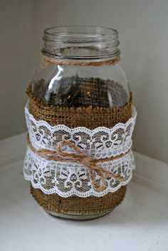 burlap and lace mason jar vase. $6.00, via Etsy.  Burlap and lace is the future theme of my wedding.