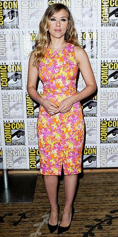 SCARLETT JOHANSSON Since Scarlett is promoting Captain America: The Winter Soldier at Comic-Con in San Diego, we imagine the temptation to wear red, white and blue was strong, but we're glad she instead went with orange, pink and yellow via a pretty floral Versace dress.