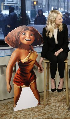 Emma Stone held hands with her Croods cardboard cutout, Eep.