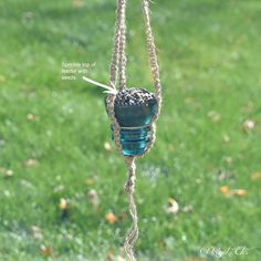 s 17 adorable birdfeeders using things you already own, outdoor living, repurposing upcycling, Fill a glass insulator with seeds and hang it