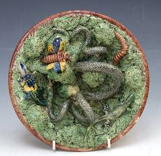 A nice and busy Portuguese Palissy lizard, moth, caterpillar and serpent plate by Mafra, with bright cobalt blue and yellow highlights. c1880  Dimensions in Inches: Dia: 8.25 ins